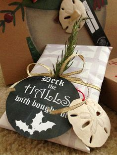 Beach gift wrapping ideas. Sea treasures picked up off the beaches of Sanibel Island were glued in the center of the ribbons.