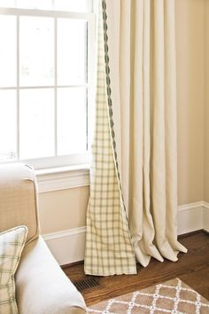 Try Reversible Panels - Curtains 101 - Southernliving. These custom-made drapery panels, with the green-and-ivory plaid visible from both inside and outside the house, help tie together the room's color palette. The curtains pool at the floor with a few inches of extra fabric, offering a look that's consistent with the room's formal decor.