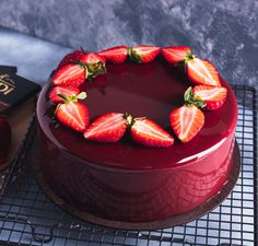 This red berry chocolate entremet is a delicay and a feast for both the eyes and the taste buds. Layers of chocolate sponge cake, red berry marmalade and chocolate mousse are covered to perfection in a mirror glaze and decorated simply. Red Glaze Recipe, Mirror Glaze Recipe, Mirror Glaze Cake, Chocolate Work, Dark Chocolate Mousse, Chocolate Sponge, Chocolate Mirror Glaze, Chocolate Glaze Cake, Entremet Recipe