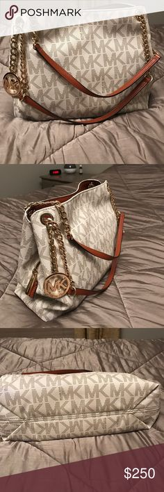 Authentic Michael kors with gold metal logo Michael kors with gold metal logo and beautiful gold metal chain handle, purchased this in Macy's last year of Oct., still looks brand new coz i just used this for a month Michael Kors Bags Shoulder Bags