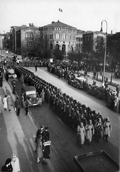 Nazi soldiers marching through the streets of occupied Oslo.