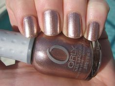 Orly Rage. Really pretty rose gold nail polish. This came in a sampler I get every 3 mos. It is a tough polish, too--does not chip easily.