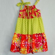 Great tutorial with step by step instructions on how to sew a Tiered Pillowcase-Style Dress.