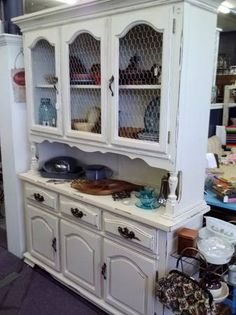 Antique White Distressed Hutch / China Cabinet. Chicken wire in place of glass makes this fabulous!  facebook.com/baauctionresale