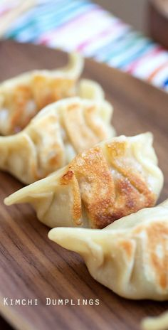 Kimchi dumplings - Korean dumplings with kimchi and pork fillings. These dumplings are really good and once you try, you will be hooked | rasamalaysia.com