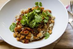 white bean & tamarind stew - swiss chard, coriander, caraway, onion, tomatoes, cannelli beans, cilantro, brown rice
