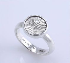 sterling silver signet ring with a single fingerprint and one 1.5mm diamond flush set