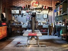 Motorcycle Garage: Build Your Own Man Cave - TunedTrends Garage Studio, Garage Shop, Garage Workshop, Car Garage, Garage Life, Workshop Storage, Motorcycle Workshop, Motorcycle Garage, Motorcycle Shop