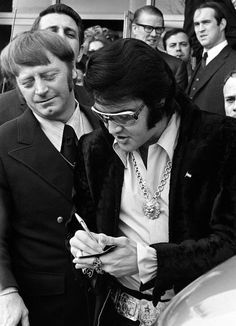 Elvis Presley Signing Autographs.  Elvis died one day after my 11th birthday.  Aug. 16, 1977. I'll never forget.