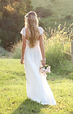Beautiful low back wedding dress with lace capped sleeves and dreamy silk chiffon skirt, fitted to the waist