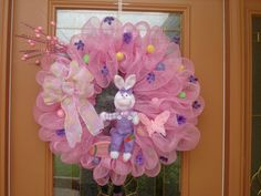 I wanna try a DIY version!! Deco Mesh Easter bunny wreath with pastel colored by DecoDzigns, $75.00
