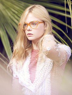 elle fanning in cat eye glasses and blonde hair