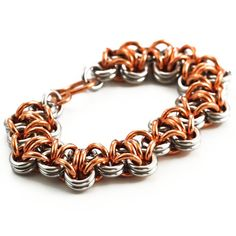 This Stainless Steel and Copper Bracelet features the Turtleback Chainmaille weave in chunky 12 gauge jump rings here at Unkamen by Jonathan Cureton.  The stainless steel in this bracelet is nickel free. I use 410 Grade Stainless Steel which is not only EU Compliant it contains ZERO nickel so this is perfect for my international customers as well as anyone with sensitive skin. Stainless steel has a grey-white silver tone, will not tarnish and will last forever.  Select your size from the…