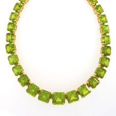 Italian 18 karat gold necklace with peridot by Dolce & Gabbana. The necklace has 29 rectangular-cut peridot stones with an approximate total weight of 220 carats. This necklace is made in a classic rivière motif with corner prong held stones. Peridot Necklace, Beaded Necklace, Beaded Bracelets, Gold Necklace, Necklaces, Fashion Necklace, Fashion Jewelry, Jade, Dolce Gabbana