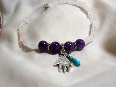 Amethyst and Rose Quartz Stretch bracelet with Fatima hand Charm, Infused with Angelic Energy
