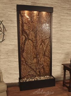The water flowing over clear glass in the 7.5\' Black Onyx Gardenfall ...