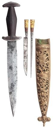Swiss dagger of Holbein type, mid-16th c., the scabbard later. Double-edged leaf-shaped blade of near-flat diamond section slightly reinforced at the point, formed w/ a short ricasso and struck with bladesmith's mark on both sides; a shaped copper fillet;   relief casts, the outer face decorated with The Dance of Death, formed with a prominent finial involving a human mask flanked by spiraling shells; tubular gilt-bronze pommel cast with a demon mask in low relief.