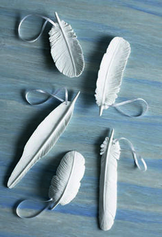 porcelain feathers- could spray paint the 'wing' pieces of driftwood I've found and bundle together hanging from twine.