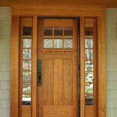 Cherry entry door accented by craftsman hardware. Integrated hidden roll out screen door for warmer seasons. --- Yep.