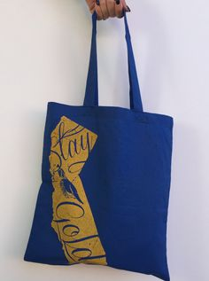 Stand out with this hand screen printed tote bag. Made in California with eco friendly materials and inks. Don't forget your bags! Perfect size for Farmers market, books, grocery, and work outs. 6 oz.