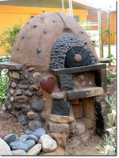 Cob oven heats up to 450 degrees F in 20 minutes, can get up to 800 degrees. FFun-tastic Permasphere, L. Arboretum PDC Permaculture Research Institute - Outside oven for Cob houses.