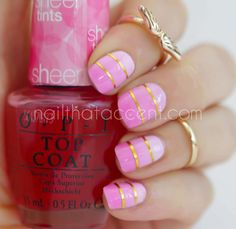 I first used two coats of Sinful Colors Snow Me White as my base. Then I used Be Magentale With Me in three separate coats. The first coast covered the whole nail, the second coat covered two thirds of my nail, and the final coat covering the top third of my nail (let each coat dry completely in between). Rather than apply a fourth layer of top coat to blend the three layers together, I used striping tape to break up the lines.