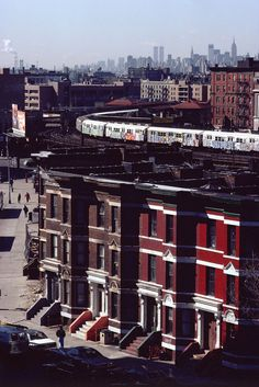 Here is a classic shot from a Queens neighborhood with graffiti filled subway cars passing by and the Manhattan skyline in the background. Also, the World Trade Center towers can be seen towering above the city. via @Juxtapoz