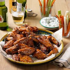 These easy-to-make sticky wings are served with a creamy yogurt dipping sauce. Chicken On A Stick, Chicken Wings, Sriracha Recipes, Hoisin Chicken, Vegetable Sticks, Duck Sauce, Hoisin Sauce, Chicken Wing Recipes, Spicy