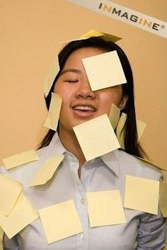 A woman enjoying the healing benefits of Post-it Notes: | 50 Completely Unexplainable Stock Photos No One Will Ever Use
