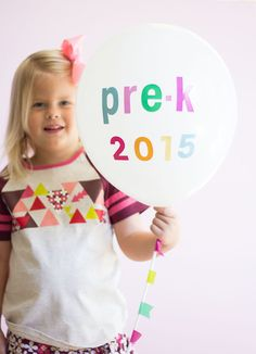 Cute idea for first day of school photo DIY: Alphabet stickers or paint pen on a balloon. Simple!  | Design Improvised