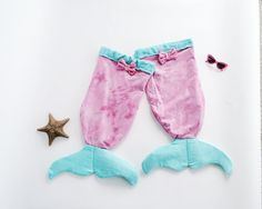 "Beautiful ""rainbow mermaid"" Mer-tail towels!!!!   Www.thetropicalmermaid.com"
