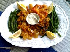 Mixed seafood fritti with jalapeno tartar sauce and grilled asparagus.