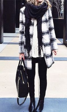 Love the outfit. Black and white coat, black pants and bag. Winter fashion trends.