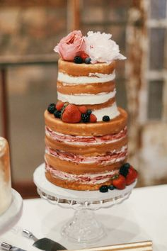 This rustic naked wedding cake looks delicious. click to see more. via Sugar Bee Sweets Bakery