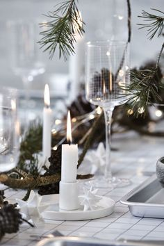 A Nordic-style monochrome Christmas table setting by House Doctor. Christmas Kitchen, Noel Christmas, Modern Christmas, Scandinavian Christmas, Rustic Christmas, Winter Christmas, Xmas, Scandinavian Living, Scandinavian Interior