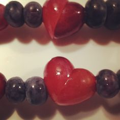 Valentine fruit!!! Cut a grape at an angle and turn it together to make a heart!!!! Cute