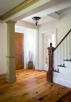 Reclaimed Rustic White Pine flooring in a Lynnfield, MA home. Wide plank format, face-nailed with cut nails.