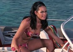 Paula Caplan was Bond's liaison in Nassau. She was played by Martine Beswick, who had previously played Bond girl Zora in From Russia With Love. Paula helped Bond but dies after being captured by SPECTRE agents, taking a cyanide pill to avoid torture. James Bond Images, James Bond Women, Honey Ryder, Bond Series, James Bond Movies, Bond Girls, Monica Bellucci, New Movies