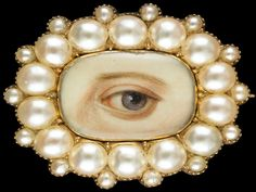 "Oval brooch and pendant surrounded by 14 split pearls with 14 small satellite pearls; brown left eye. Inscribed initials on reverse: ""J.A.T.,"" ""W.V.T.,"" ""J.M.T."" Circa 1835–40"