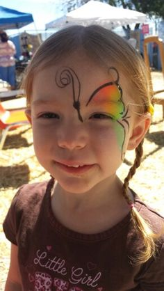 Face painting rainbow butterfly