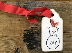 """JOY"" Gift Tag These gorgeous handmade tags are a great way to show your support and excitement for your friend/wife/partner/co-worker's approaching baby over the Holiday! Each one will be placed on t"