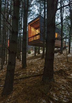 "Wilderness cabins were built on concrete piers to minimize the impact on the land and hover above the surrounding area creating a ""house in the trees"" feeling and a sense of privacy in Minnesota by HGA Architects and Engineers. Forest Cabin, Forest House, Cabin Design, House Design, Casas Containers, Cabin In The Woods, Mountain Homes, Architecture Design, Exterior"