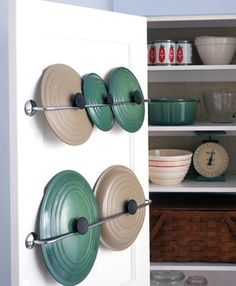 DIY kitchen storage. Towel racks for lid storage. Makes more room for pots and pans in the cabinet.