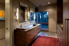 The main bathroom includes a concrete vanity counter with an integral sink. The wall is clad in quartzite mosaic tile.