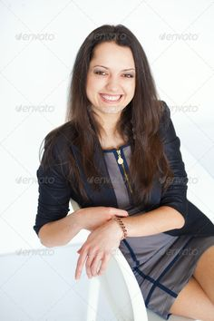 Young smiling brunette business woman sitting on a chair ...  adult, attractive, background, beautiful, black, brunette, business, businesswoman, caucasian, chair, cheerful, confidence, cute, dress, elegance, fashion, female, flirt, friendly, girl, hair, happiness, human, jacket, laugh, leg, looking, office, one, only, people, person, portrait, positivity, pretty, professional, relaxation, rest, seat, secretary, sensuality, sexy, sitting, smiling, success, toothy, white, woman, worker, young