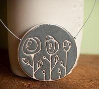 lovely pendant by Soleil Fleming (etsy artist Maboue) - porcelain jewellery wax resist? Porcelain Jewelry, Porcelain Clay, Ceramic Jewelry, Enamel Jewelry, Ceramic Clay, Ceramic Beads, Ceramic Pottery, Cement Jewelry, Ceramic Pendant