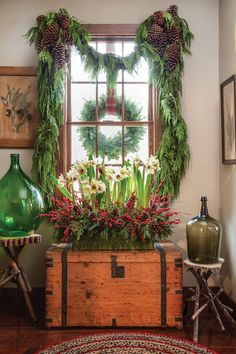 Amaryllis_HollyBerry_Arrangement-christmas-wreath-evergreen-garland-country-holiday-decorating-ideas-Washington, D., event planners Rick Davis and Christopher Vazquez - The Glam Pad Christmas Greenery, Rustic Christmas, Winter Christmas, Christmas Home, Christmas Mantles, Christmas Villages, Vintage Christmas Decorating, French Country Christmas, Cottage Christmas