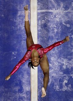 San Jose, US: Gabby Douglas performs on the balance beam during the preliminary round of the women's Olympic gymnastics trials