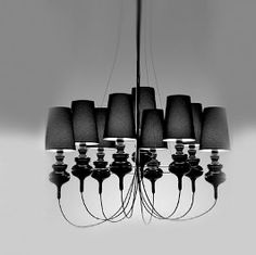 9 bodies spider light mounted on a metal porcelain ring.
