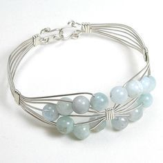 Handmade gemstone aquamarine and silver wire bracelet features semi-precious, round aquamarine gemstones, and hook clasp. Add a necklace, pendant and earrings to compliment this bracelet Wire Jewelry Designs, Handmade Wire Jewelry, Wire Wrapped Jewelry, Metal Jewelry, Jewelry Crafts, Beaded Jewelry, Bracelet Fil, Homemade Jewelry, Jewelery